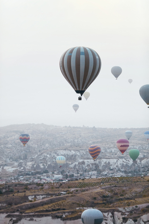 Ballooning In Nature. Hot Air Balloons Flying Above Valley, Travel In Colorful Balloons At Cappadocia. High Resolution Standard-Bild - 115069403