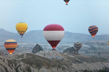 Colorful Hot Air Balloons Flying In Sky Above Rock Valley At Cappadocia Turkey. High Resolution Standard-Bild - 115069404
