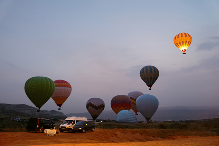 Hot Air Balloons Beginning To Fly At Valley In Early Morning, Starting Flying. High Resolution Standard-Bild - 115069405