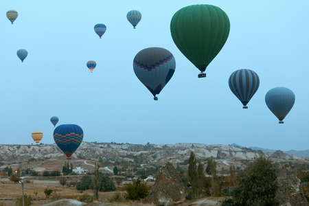Travel. Colorful Hot Air Balloons Flying Above Cappadocia Early In Morning, Ballooning In Nature. High Resolution Standard-Bild - 115069409