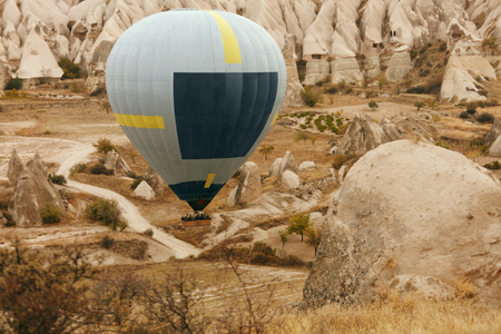 Travel. Hot Air Balloon Flying Above Rock Valley, Ballooning In Cappadocia Turkey. High Resolution Standard-Bild - 115069410