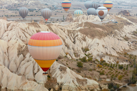 Colorful Hot Air Balloons Flying In Sky Above Mountains At Cappadocia. High Resolution Standard-Bild - 115069422
