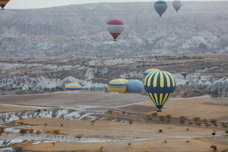 Hot Air Balloons Flying Above Rock Valley At Cappadocia Turkey. High Resolution Stock Photo