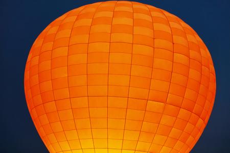 Orange Hot Air Balloon In Dark Blue Sky Closeup In Cappadocia Turkey. High Resolution Standard-Bild - 115069432