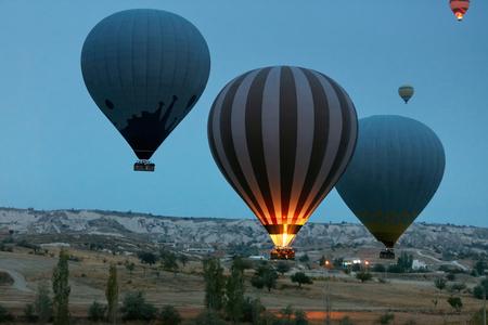 Travel. Hot Air Balloons Flying Above Valley In Early Morning. Ballooning At Cappadocia Turkey. High Resolution Standard-Bild - 115069433