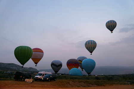 Hot Air Balloons Beginning To Fly At Valley In Early Morning, Starting Flying. High Resolution Standard-Bild - 115069439