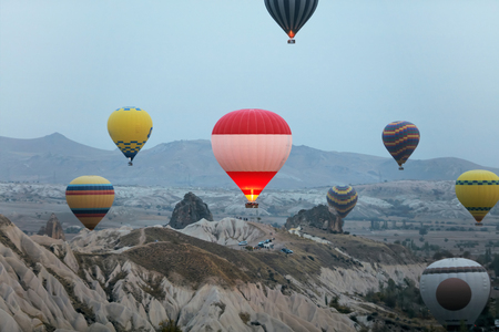 Colorful Hot Air Balloons Flying In Sky Above Rock Valley At Cappadocia Turkey. High Resolution