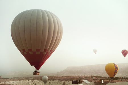 Travel. Beautiful Hot Air Balloon Flying In Sky Above Valley In Cappadocia View From Car. High Resolution Standard-Bild - 115069451