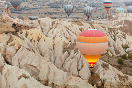 Colorful Hot Air Balloons Flying In Sky Above Mountains At Cappadocia. High Resolution Standard-Bild - 115069671