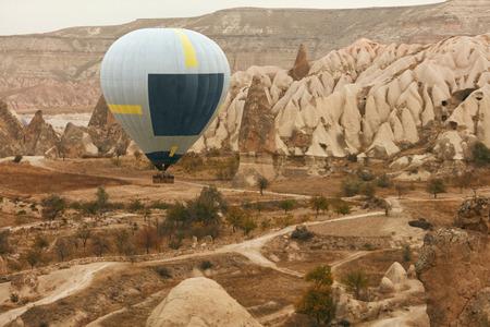 Travel. Hot Air Balloon Flying Above Rock Valley, Ballooning In Cappadocia Turkey. High Resolution Standard-Bild - 115069673