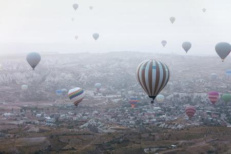Hot Air Balloons Flying Above Rock Valley At Cappadocia Turkey. High Resolution Stock Photo