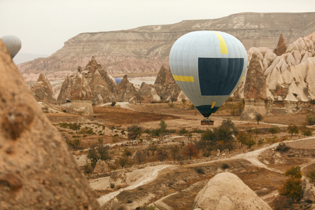 Travel. Hot Air Balloon Flying Above Rock Valley, Ballooning In Cappadocia Turkey. High Resolution Standard-Bild - 115069675