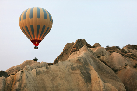 Hot Air Balloon Flying In Beautiful Nature Landscape With Rocks, Balloon Above Stone Hills. High Resolution Standard-Bild - 115069677