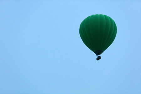 Ballooning. Green Hot Air Balloon Flying High In Blue Sky. High Resolution Standard-Bild - 115069682