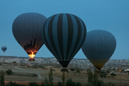 Travel. Hot Air Balloons Flying Above Valley In Early Morning. Ballooning At Cappadocia Turkey. High Resolution Standard-Bild - 115069684