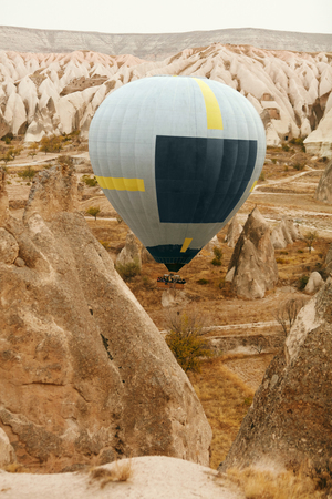 Travel. Hot Air Balloon Flying Above Rock Valley, Ballooning In Cappadocia Turkey. High Resolution Standard-Bild - 115069686