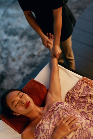 Thai Body Massage. Beautiful Asian Woman Getting Hand Massage At Spa, Relaxing At Resort. High Resolution 写真素材