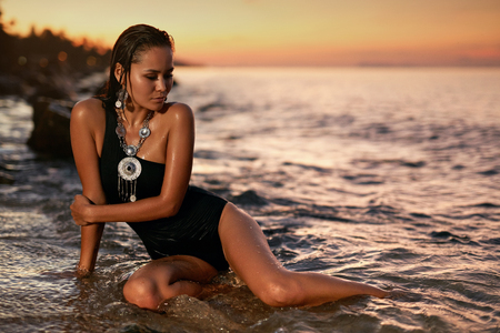 Woman Fashion And Summer Style. Girl In Black Swimsuit In Sea. Asian Female With Sexy Body In Water. High Resolution 版權商用圖片
