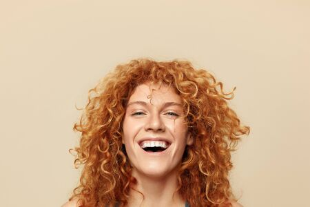 Redhead Woman. Cheerful Girl Close Up Portrait. Beautiful Female With Curly Red Hair Looking At Camera. Face Expression And Natural Emotions. Фото со стока