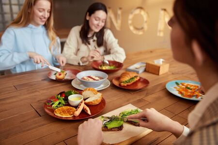 Lunch. Young Women Eating In Cafe. Smiling Girls Having Breakfast And Talking. Friends Meeting In Restaurant As Part Of Lifestyle.