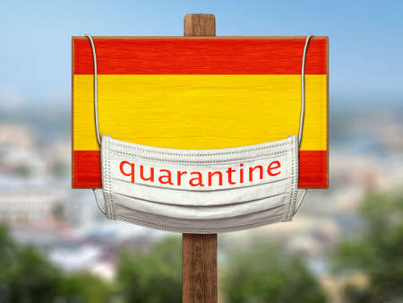 The sign on the background of the city. Quarantine during   pandemic in Spain. A medical mask with the words