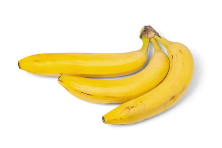 Yellow bananas isolated on white background. Three ripe bananas. Bunch of yellow bananas on a white surface. Exotic, tropical fruits. Healthy eating.