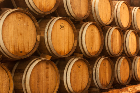 Wooden oak brandy wine grape barrels rows photo