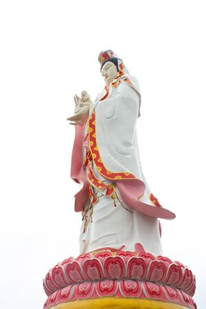 goddess of mercy: The large beautiful Goddess of Mercy guan yin on white background isolated, Wat Sman Rattanaram, Thailand. Stock Photo