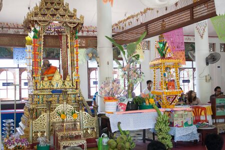 participate: SARABURI - November 8: People participate in annual merit-making ceremony called Thot Kathin in Thailand at Thachang Tai Temple in Saraburi, Thailand on November 8, 2015.