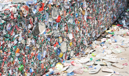 crushed cans: SARABURI, THAILAND - 16 MARCH 2016 : Baled aluminum cans at an undisclosed recycling facility,The cans will be shipped to an aluminum foundry Stock Photo