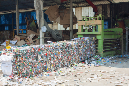 crushed cans: SARABURI, THAILAND - 16 MARCH 2016 : Line of baled aluminum cans at an undisclosed recycling facility,The cans will be shipped to an aluminum foundry Stock Photo