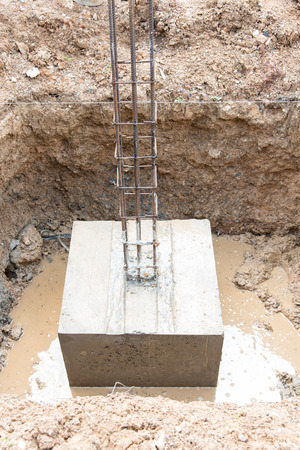 footing: Concrete footings for the foundation in house construction Stock Photo