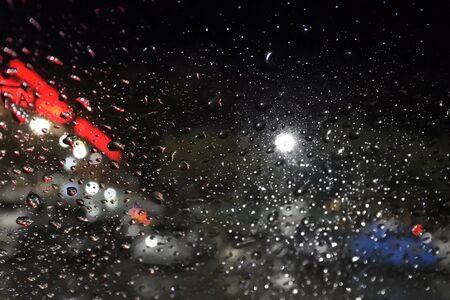 wet wallpaper: Rain drops on window with street blur lights