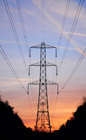Sunset behind electricity pylon in England