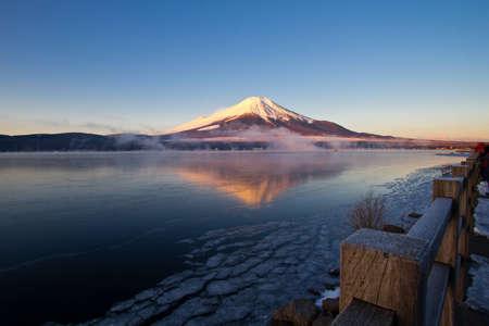 fuji: Mount Fuji,Pre-dawn view of Mount Fuji with mirror reflection in lake Stock Photo