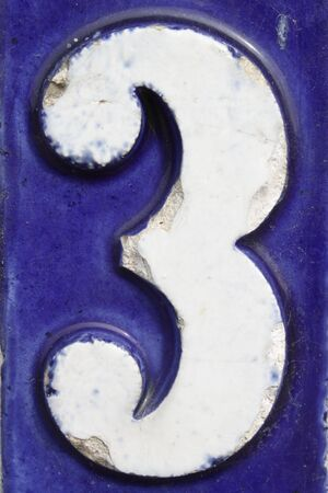 Number three on blue address plate Standard-Bild