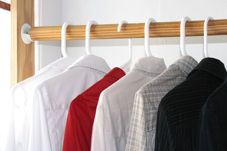 Shirts of different colors in the closet Stock Photo