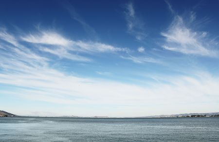 Blue sky with white clouds over sea Stock Photo