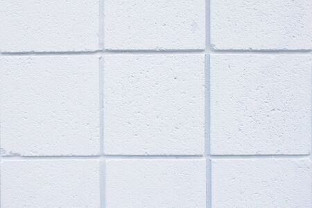 Closeup of the white tiled wall of a house  Stock Photo