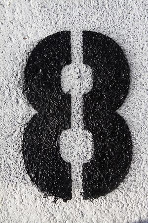 Black number eight painted on the asphalt Stock Photo