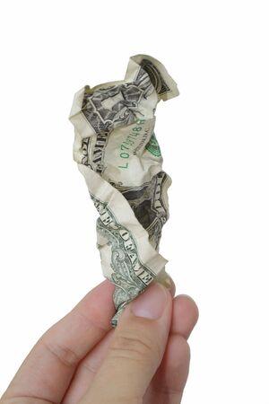 白い背景の上のしわくちゃの 1 ドル札