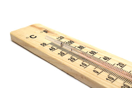 Closeup photo of wooden thermometer on white background