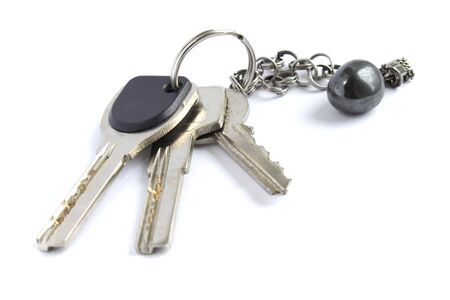 Bunch of keys with metal chain and hematite stone isolated on white background photo