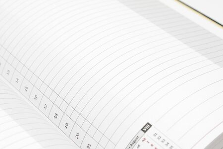 White lined diary page with black numbers Stock Photo