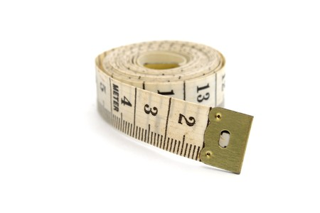 Rolled measuring tape isolated on white background photo