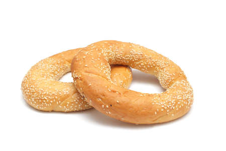 Two bagels with sesame seeds isolated on white background