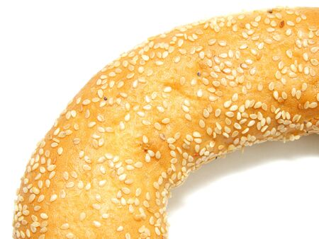 A part of a bagel with sesame seeds on the white background Stock Photo