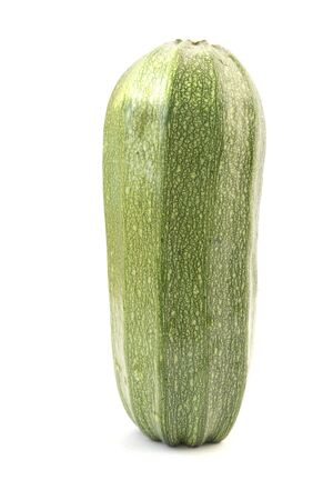 Single green zucchini isolated on white background
