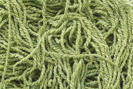 Background with green woolen yarn