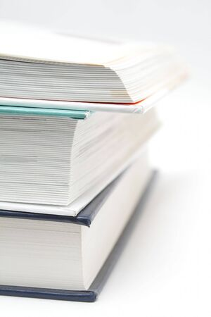 Stack of three books, upper is opened Stock Photo